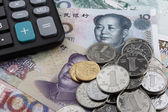 Chinese money (RMB) and a calculator. — Stock Photo