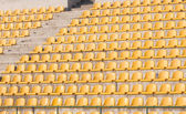 Yellow chairs on the soccer field — Stock Photo