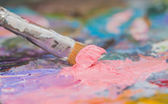 Pink paint brushes and oil paints — Stock Photo