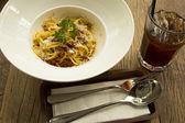 Spaghetti in white dish — Stock Photo