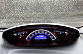 Dashboard and rain droplets on car windshield — Stock Photo