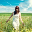 Young woman in white dress in the colorful meadow — Stock Photo #64978945