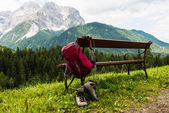 Hanging backpack and hiking shoes — Stock Photo