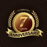 Celebrating 7 Years Anniversary, Golden Laurel Wreath Seal with Golden Ribbon — Stock Vector #52419267