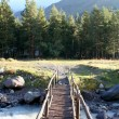 Bridge through the mountain small river — Stock Photo #56499823