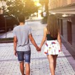 Young couple walking through the city holding hands — Stock Photo #79373700