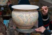 Pottery decorating — Stock Photo