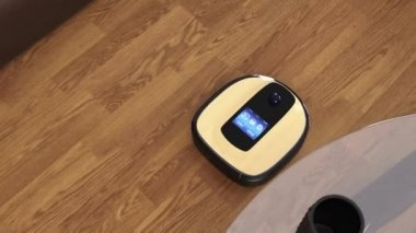 Robot vacuum cleaner moving on flooring — Vídeo de stock