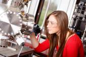 Female scientist looking to the laser deposition chamber — Stock Photo