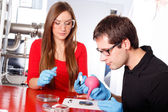 Scientists working with deposition substrates — Stock Photo