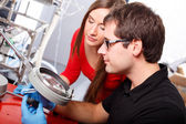 Scientists working with magnifier — Stock Photo