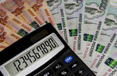 The calculator on the background of Russian money. — Stock Photo