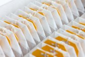 Detail of packed yellow tagged tea bags — Stock Photo
