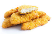 Golden fried bread crumbed chicken strips. — Stock Photo