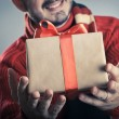 Male giving a gift box — Stock Photo #56492453