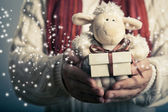 Lamb toy and christmas gift — Stock Photo