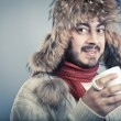 Man warm up with cup of hot beverage. — Stock Photo #58908783