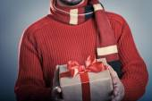 Male with red ribbon gift box — Stock Photo