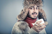 Man warm up with cup of hot beverage. — Stock Photo