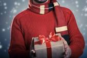 Man with red ribbon gift box — Stockfoto