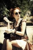 Beautiful  steampunk woman smoking — Stock Photo