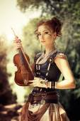 Beautiful redhair woman with body art on her face holding violin — Stock Photo