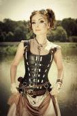 Beautiful steampunk redhair woman with body art on her face outd — Stock Photo