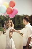 Love and wedding concept. Young attractive happy couple with col — Stock Photo