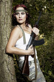 Young woman with gun — Foto Stock
