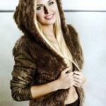 Beautiful blonde girl in fur with hood — Stock Photo #61200393