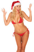 Santa Claus girl in a bathing suit — Stock Photo
