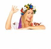Attractive woman wears Ukrainian national dress behind board — Stock Photo