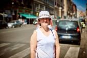 Stylish woman in hat to go in a street — Foto de Stock