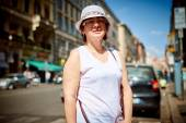 Stylish woman in hat to go in a street — Stock Photo