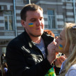 Peace March, participants draw on their faces, Ukrainian flag — Stock Photo #53780235