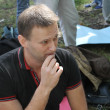 Opposition leader Alexei Navalny listens to speeches at the meeting of activists in Khimki forest. — Stock Photo #65472817