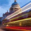 Light trails of buses at the St Pauls Cathedral in London — Stock Photo #52109841