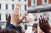 Raising hands — Stock Photo