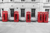 Re phone boxés in London in a row, processed in a chroma key variation — Stock Photo