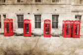 Picture of red phone boxés in London processed with a vintage texture — Stock Photo