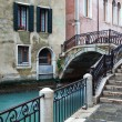 Typical canal scene with an old bridge in Venice, Italy — Stock Photo #52157655