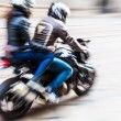 Motorcycle rider with pillion passenger with motion blur — Stock Photo #52165739