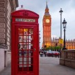 Typical red phone box in London with the Big Ben in the background — Stock Photo #52214871