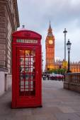 Typical red phone box in London with the Big Ben in the background — Stock Photo