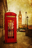Vintage style picture of a typical red phone box in London with the Big Ben in the background — Stok fotoğraf