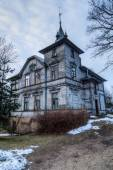 Old and scary look house in Riga — Stock Photo