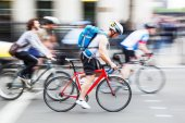 Cyclists on a city street in motion blur — Stock Photo