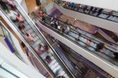 Escalators with people in motion blur — Stock Photo