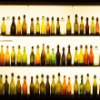 Old beer bottles in a lightened window display of a brewery in Cologne — Stock Photo #52357755
