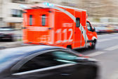 Ambulance vehicle in motion blur — Stock Photo